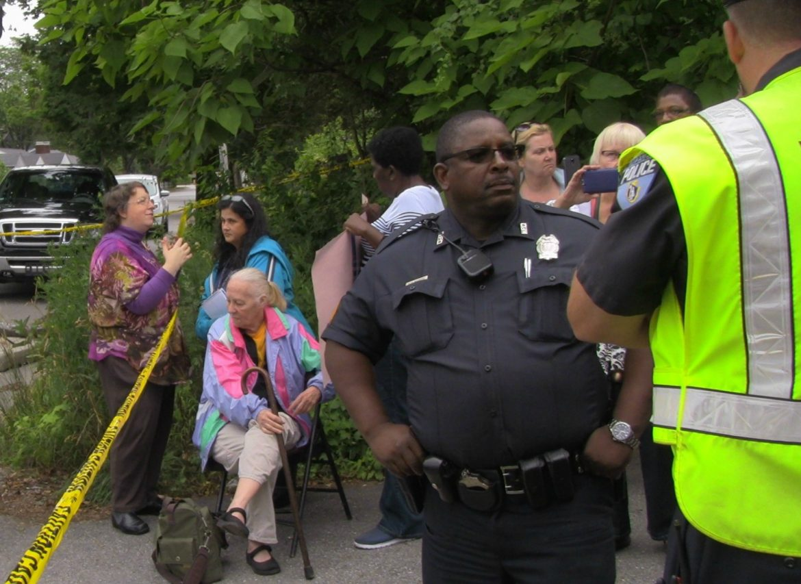Grace Ross, far left, protesters and law enforcement coexist at an eviction blockade earlier this year.