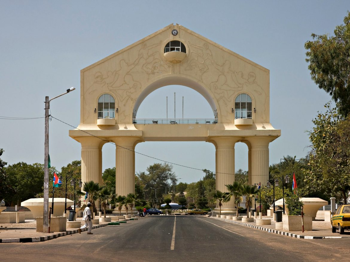 Banjul, Gambia, marked by its imposing arch standing sentry on the road into town, is now in the Kanjia family's rear-view mirror.